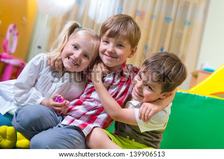Happy excited children having fun at home - stock photo