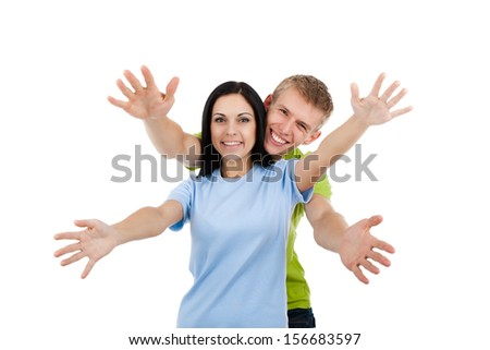 Happy excited smiling friends man and woman holding open palm at you, young people students girl and guy show welcome freedom gesture isolated on white background - stock photo