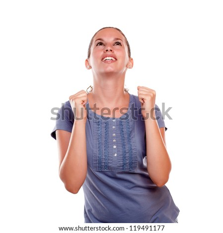 Happy excited young female celebrating a victory on blue shirt on white background - stock photo