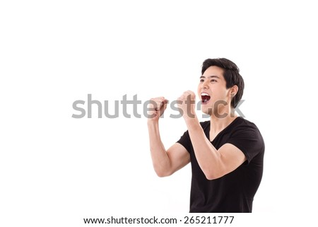 happy, exited man shouting, raising his arms up - stock photo