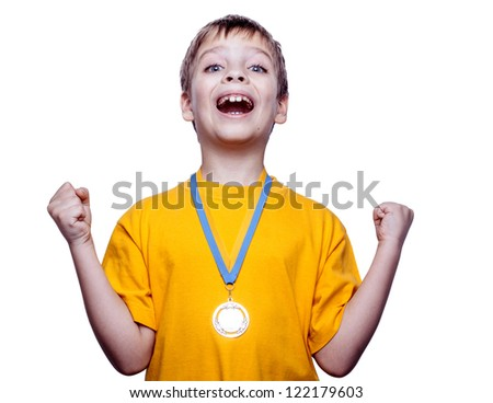Happy expressive child i with medal isolated on white - stock photo