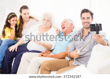 Happy extended family taking selfie at home - stock photo
