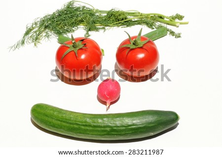 Happy face made of vegetables - tomatoes, cucumber, radish and dill herbs on white background. Top view - stock photo