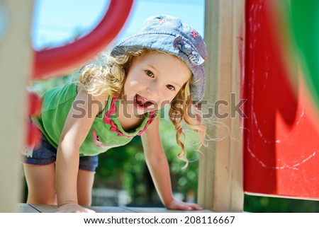 happy face of toddler on the playground - stock photo
