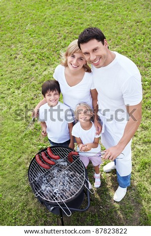 Happy families on a barbecue - stock photo