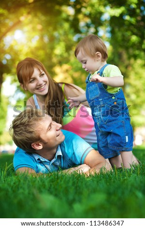 happy family are walking in the green summer park. picnic - stock photo