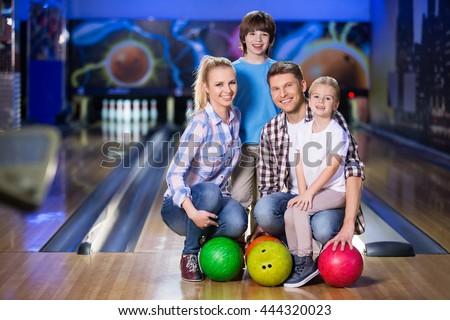 Happy family at bowling - stock photo