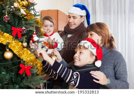 Happy family at Christmas time or winter holiday season - stock photo