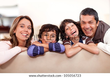 Happy family at home having fun and smiling - stock photo