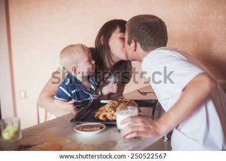 Happy family at kitchen with homemade pie - stock photo