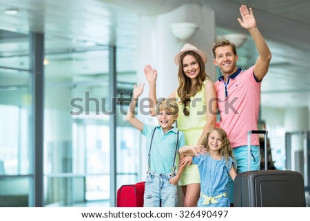 Happy family at the airport - stock photo