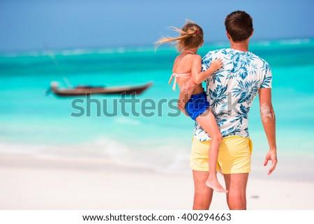 Happy family at tropical beach  - stock photo