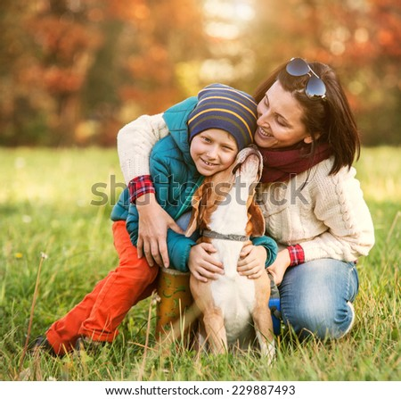 HAppy family autumn portrait - mother with son and pet - stock photo