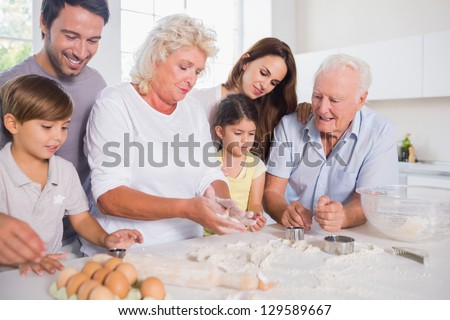 Happy family baking together in the kitchen - stock photo