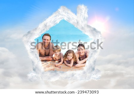Happy family beside the swimming pool against blue sky with white clouds - stock photo