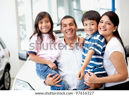 Happy family buying a new car at the dealer - stock photo