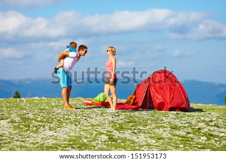 happy family camping in mountains - stock photo