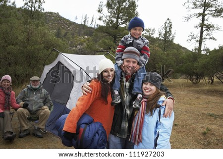 Happy family camping together - stock photo