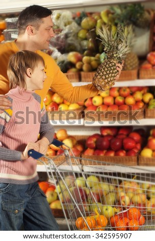 Happy family  chooses products in the store - stock photo