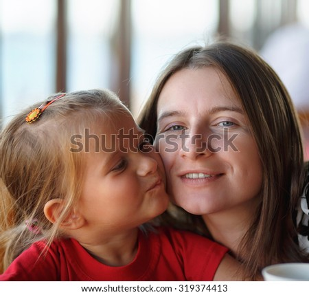 Happy family. Close-up portrait of a mother and her little daughter. Selective focus. - stock photo
