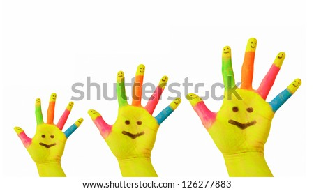 Happy family concept. Father, mother, baby colorful painted hands with smiley face drawn on yellow palms and each finger raised up. Joy and fun. Isolated on white background - stock photo