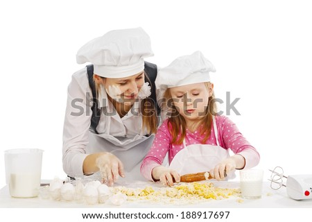 Happy family cooking  together in the kitchen  - stock photo