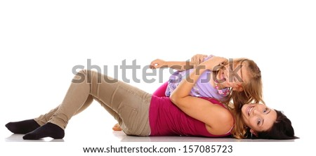 Happy family, cute little girl child playing with mom together doing fun. Daughter and her mother isolated on white - stock photo