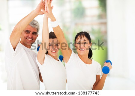 happy family doing high five after exercising at home - stock photo