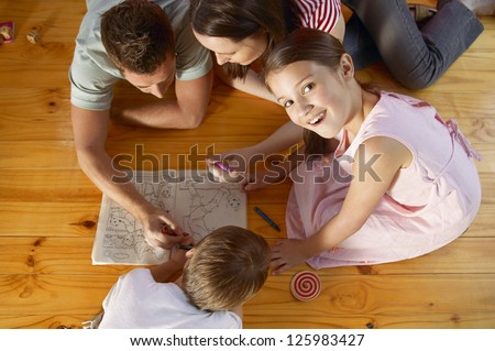 Happy family drawing and spending time together - stock photo
