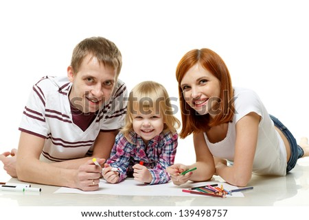 Happy family drawing picture on a white background. - stock photo