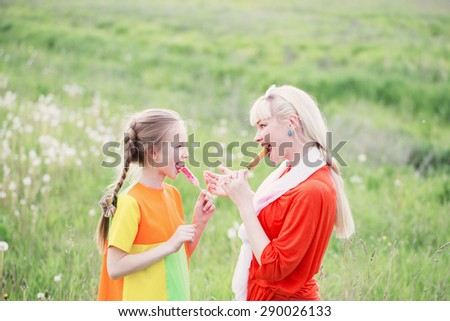 Happy family eating ice-cream outdoors - stock photo