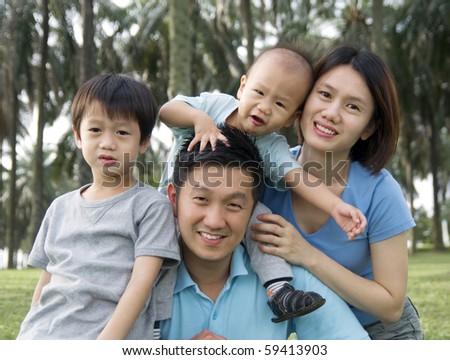 Happy family enjoy outdoor activities - stock photo