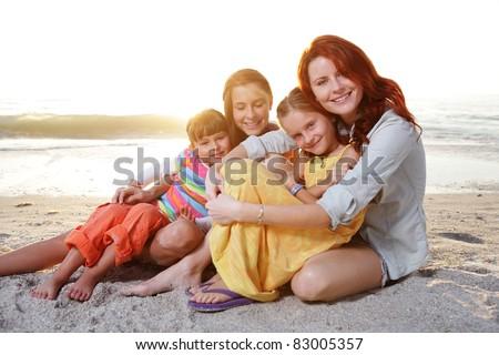 Happy family enjoy summer day at the beach. - stock photo