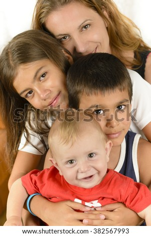 Happy Family enjoying togetherness, smiling and embracing isolated on white - stock photo