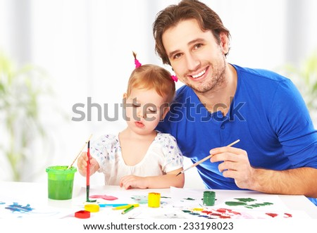 happy family father and child baby daughter together draw paints - stock photo