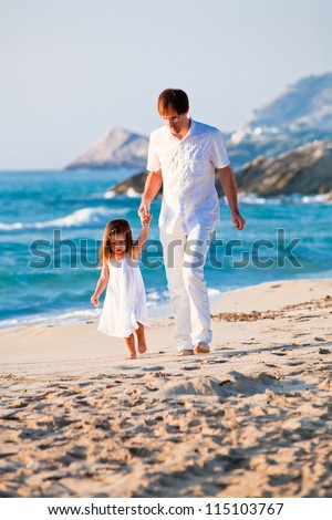 happy family father and daughter on beach having fun summer vacation - stock photo