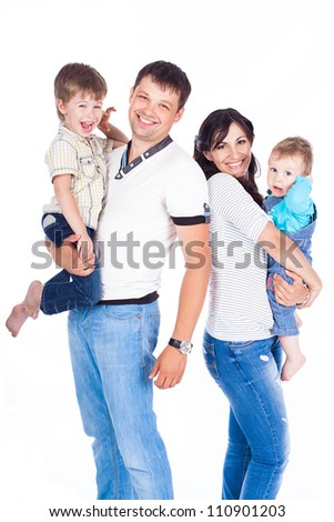 Happy family father and mother with children posing in the studio on a white background. A series of photos in my portfolio. - stock photo