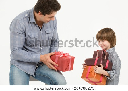 Happy family, father gives gifts to his son - stock photo