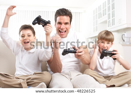 Happy family. Father, mother and children playing a video game - stock photo