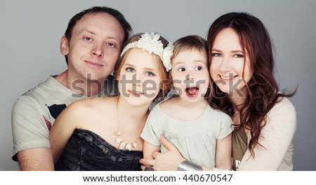 Happy Family. Father, Mother and  two Children (3 and 10 years old) - stock photo