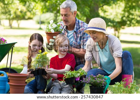 Happy family gardening on a sunny day - stock photo