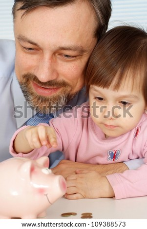 Happy family gets along well with each other at home - stock photo
