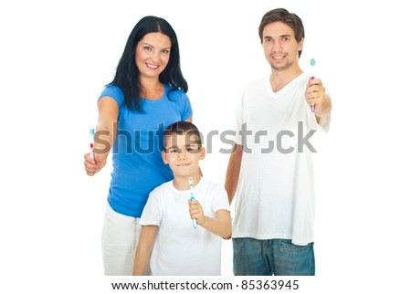 Happy family giving  or showing their toothbrushes isolated on white background - stock photo