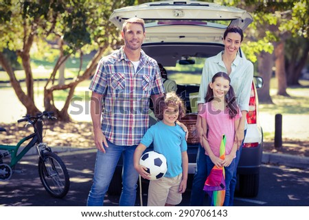Happy family going for a camping in the park on a sunny day - stock photo