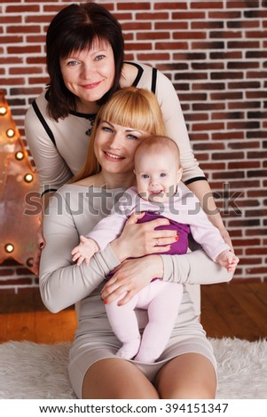 Happy family: grandmother, mother and granddaughter - stock photo