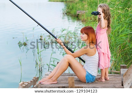 Happy family. Happy mother and daughter together outdoors. Conceptual idea - healthy lifestyle. Happy people. - stock photo