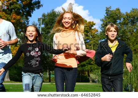 Happy family have fun and stroll in park - stock photo
