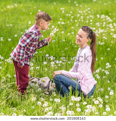Happy family have fun in the park - stock photo