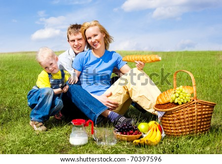 happy family having a picnic outdoor on a summer day - stock photo