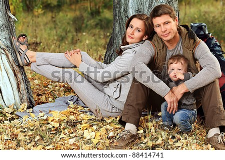 Happy family having a rest outdoor. - stock photo